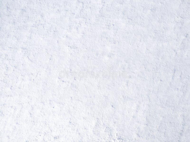 Textura de la nieve fresca blanca que chispea en el sol, fondo natural del invierno imagen de archivo libre de regalías