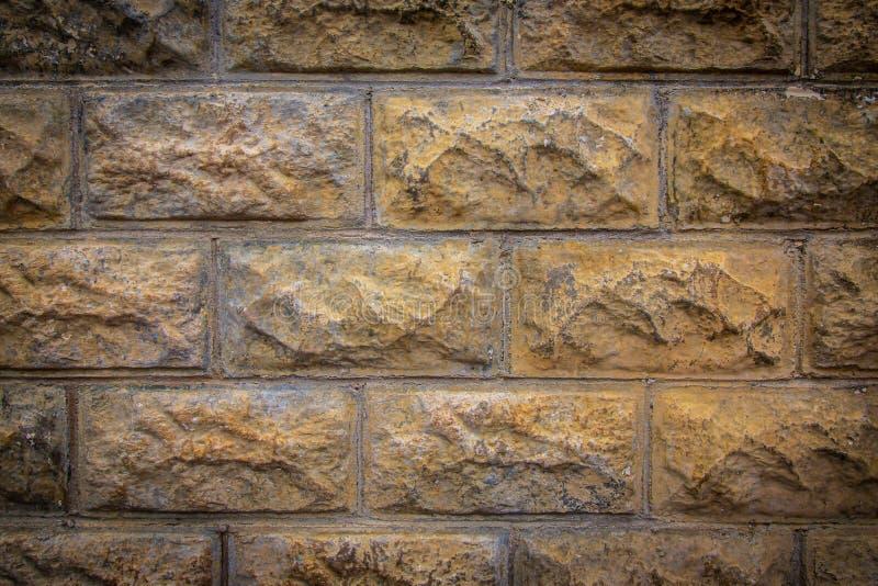 Textura de la pared de ladrillo con una ilustración ligera imagenes de archivo