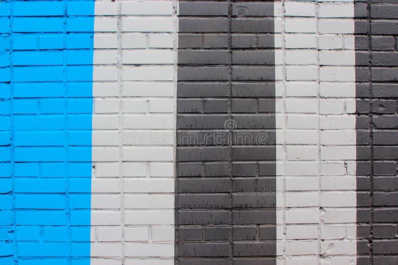 Textura de la pared de ladrillo, pintura del edificio en rayas foto de archivo