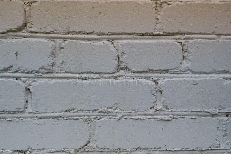 Textura de la pared de piedra blanca del desván del ladrillo de la construcción con las costuras Los antecedentes imagen de archivo libre de regalías