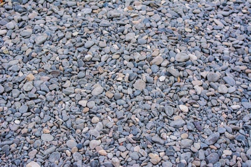 Textura de la pequeña roca de las piedras de la grava gris fotografía de archivo