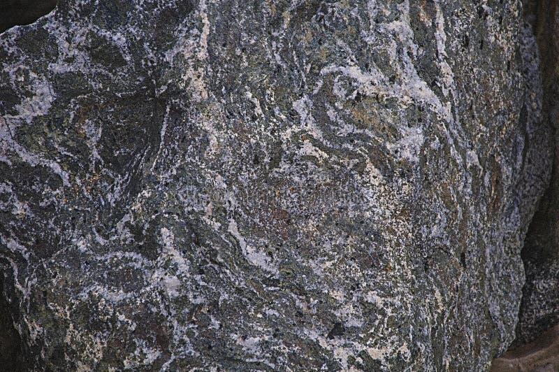 Textura de la piedra natural Fondo Textured Gris, verde, blanco y púrpura fotografía de archivo