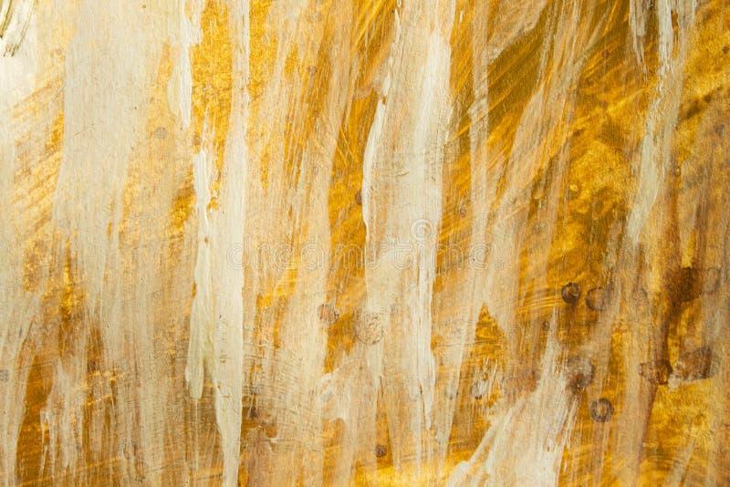 Textura de la pintura acrílica del oro y fondo blanco imagenes de archivo