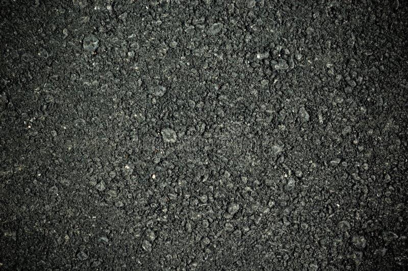 Textura de la pista de despeque del alquitrán del asfalto fotos de archivo