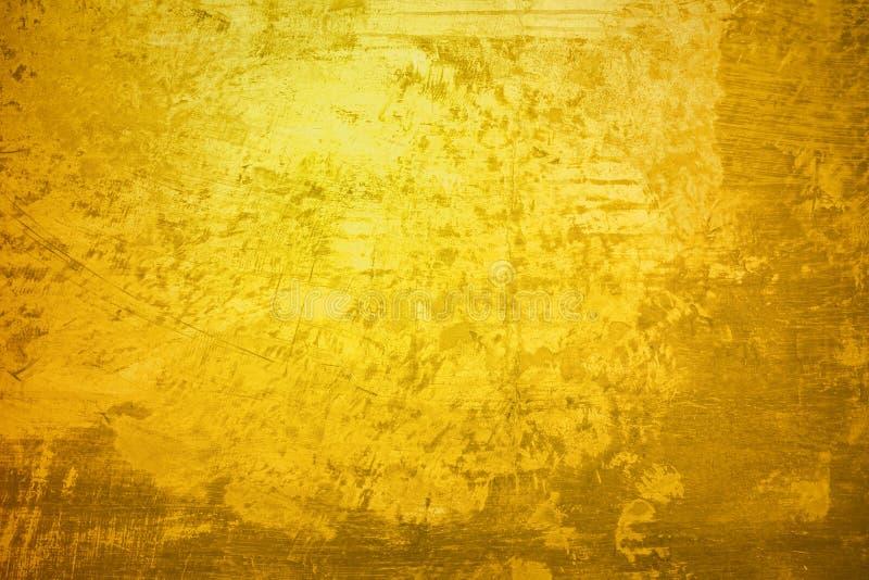 Textura de la superficie de la pintura de la pared del oro para el fondo imágenes de archivo libres de regalías