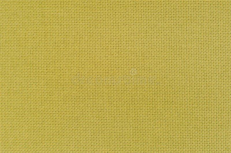Textura de la tela amarilla del lino del color Opinión del primer para fotos de archivo libres de regalías