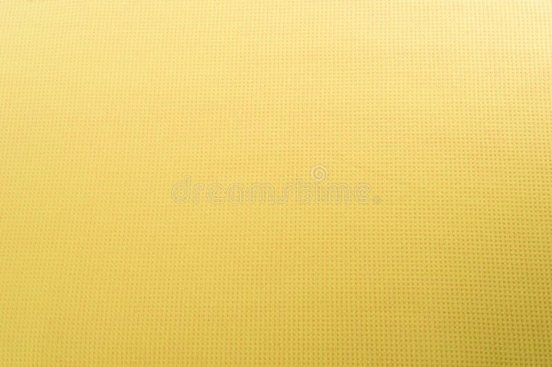 Textura de la tela de algodón amarilla como fondo abstracto. foto de archivo libre de regalías
