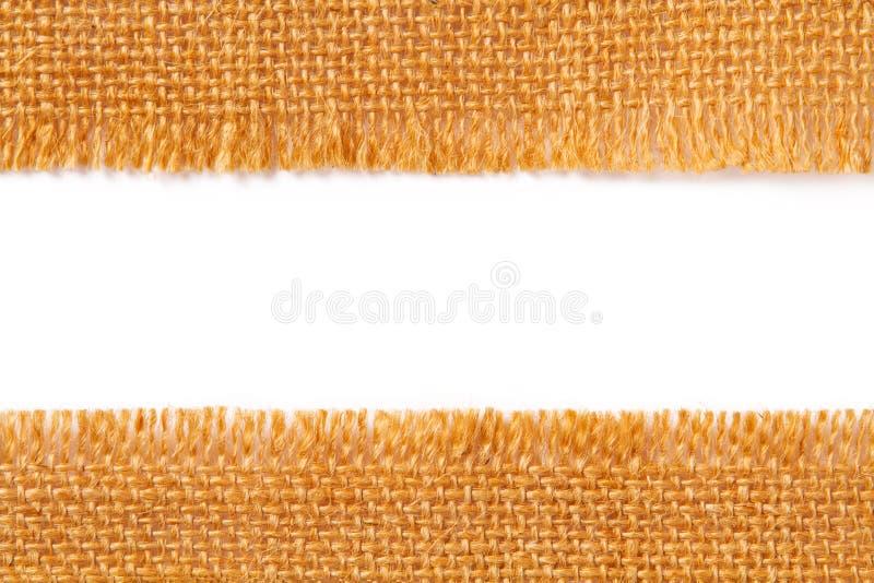 Textura de la tela de la frontera del paño de despido de lino rasgado, borde rasgado o fotografía de archivo