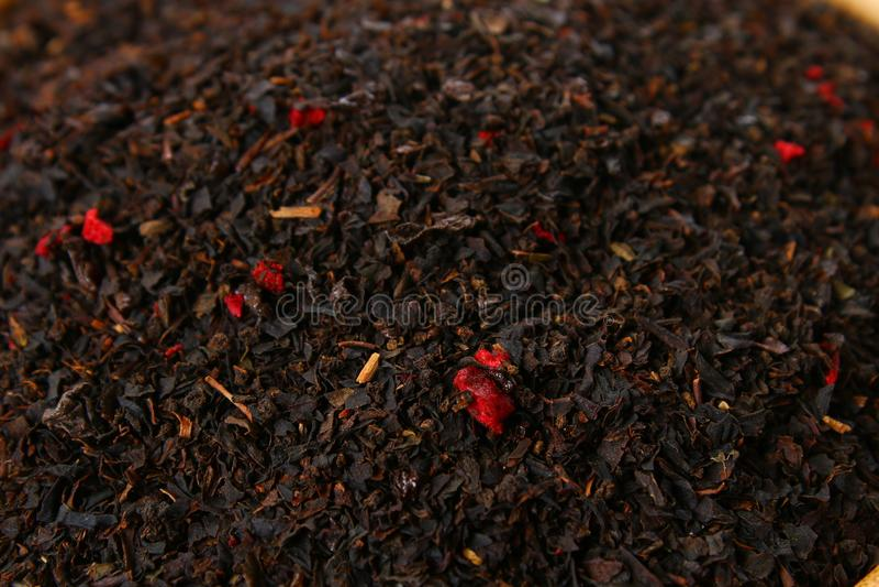 Textura de las hierbas del té Té negro Hojas de té negras secadas orgánicas fotos de archivo libres de regalías