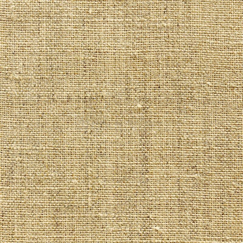 Textura de lino amarilla para el fondo foto de archivo
