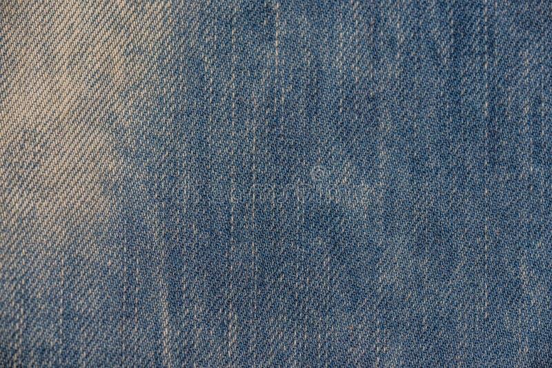 Textura de los pantalones vaqueros Tela del dril de algodón imagenes de archivo