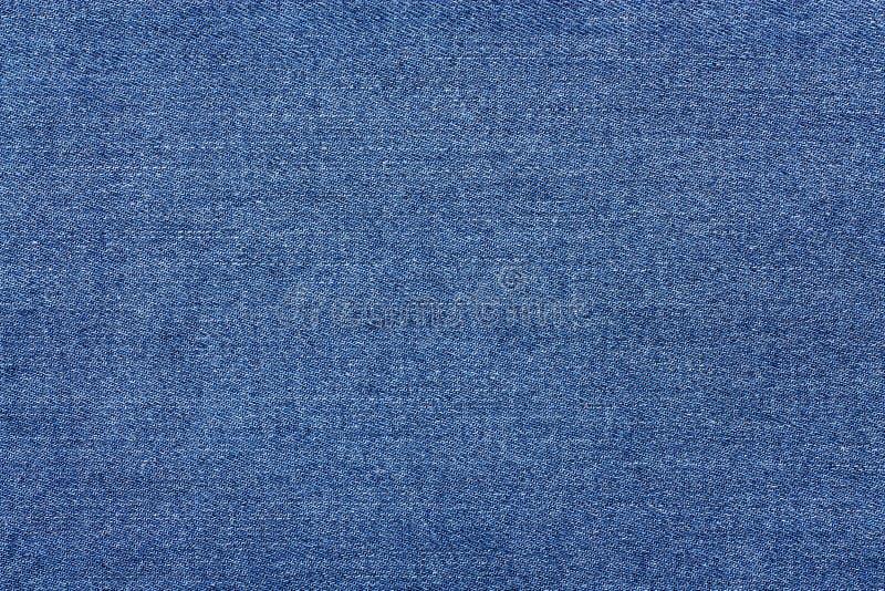 Textura de los tejanos Antecedentes de la tela del dril de algodón fotografía de archivo