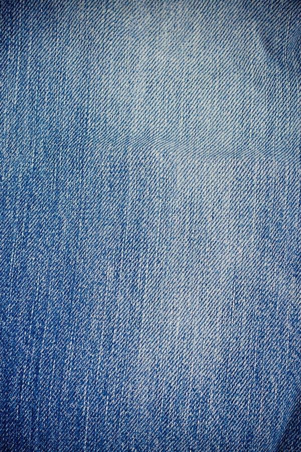Textura de los vaqueros del dril de algodón para fondo azul del dril de algodón de la textura del dril de algodón de la lona del  imagen de archivo libre de regalías