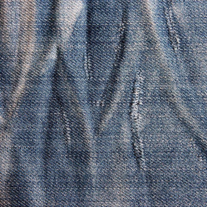 Textura de los vaqueros del vintage con rascado. imagenes de archivo