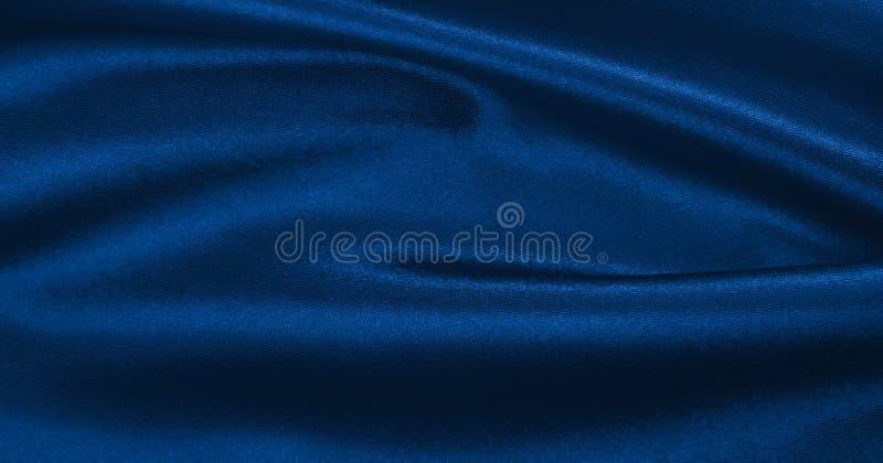 Textura de lujo azul elegante lisa del paño de la seda o del satén como abstra imagen de archivo