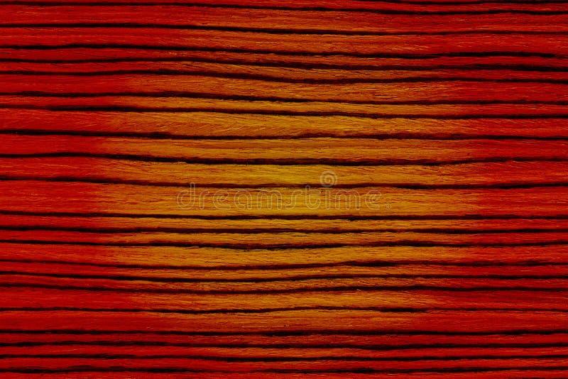 Textura de madeira listrada amarela da luz vermelha fotografia de stock