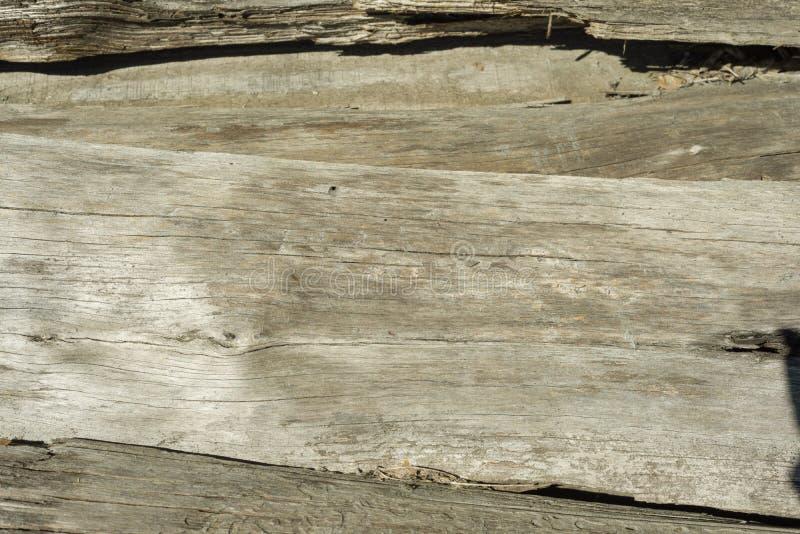 A textura de madeira velha com testes padrões naturais com cor rachada, fundo imagens de stock royalty free