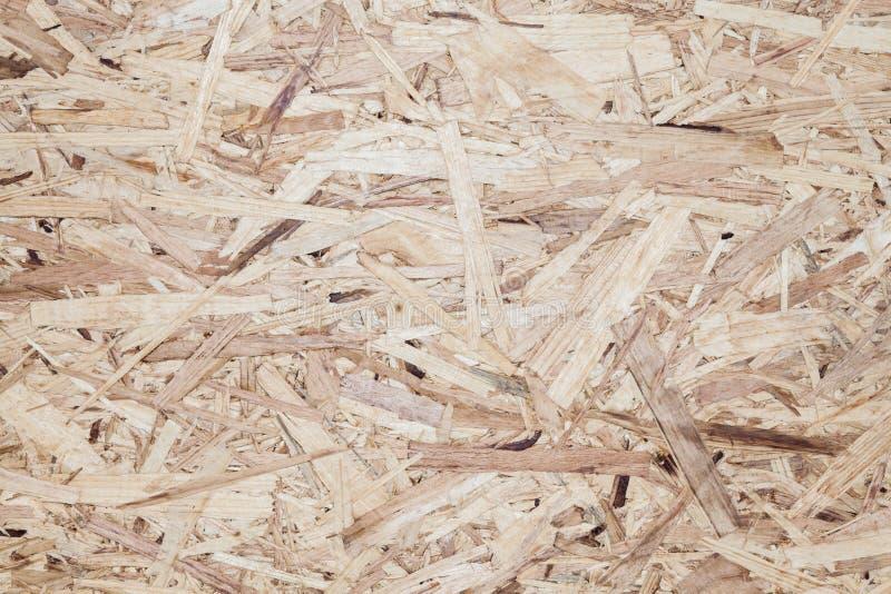 Textura de madera del fondo del panel de fibras de madera de Osb fotografía de archivo libre de regalías