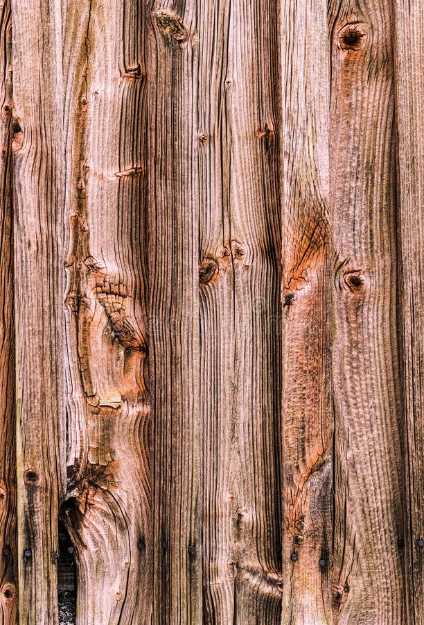 Textura de madera del fondo Superficie de madera resistida de una pared del granero foto de archivo