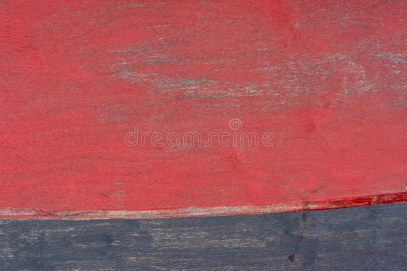 Textura de madera natural de la foto pintada en rojo y azul foto de archivo
