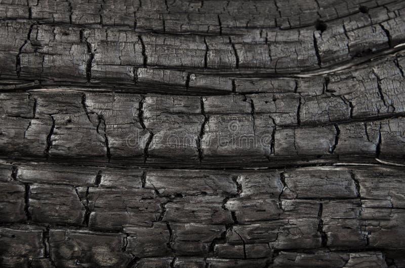 Textura de madera quemada, fondo fotos de archivo