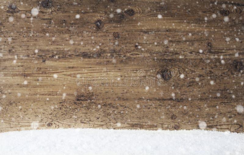 Textura de madera rústica, fondo con los copos de nieve, espacio de la copia, nieve foto de archivo