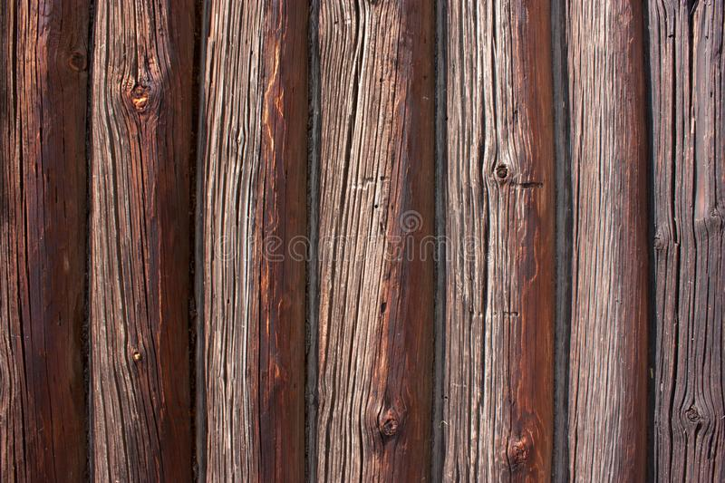 Textura de madera, registros de madera viejos, superficie marrón resistida del haz, pared de madera, fondo abstracto, contexto re foto de archivo