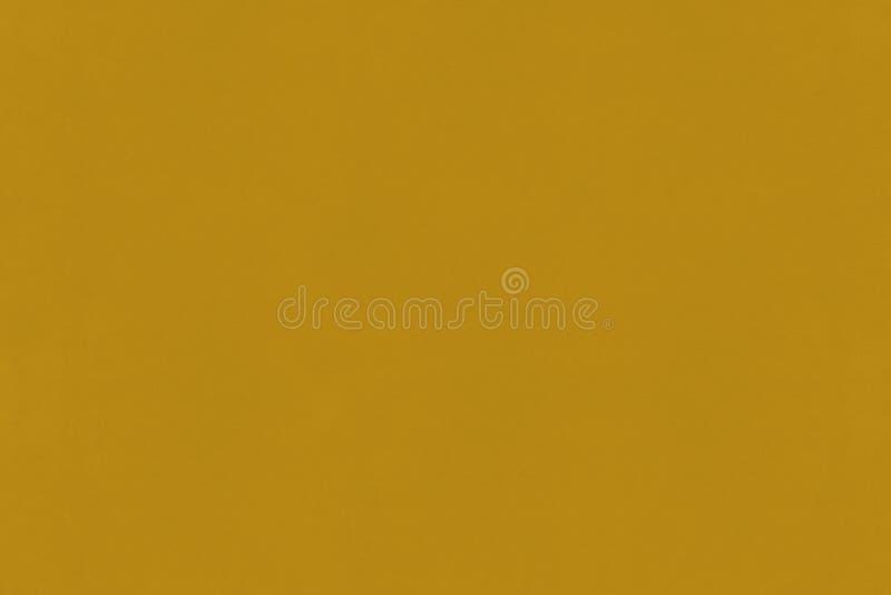Textura de papel del color de la mostaza morena imagenes de archivo