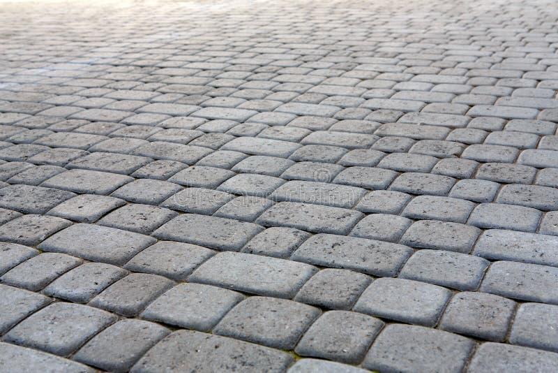 Textura de pavimentación de piedra Fondo abstracto del pavimento foto de archivo libre de regalías