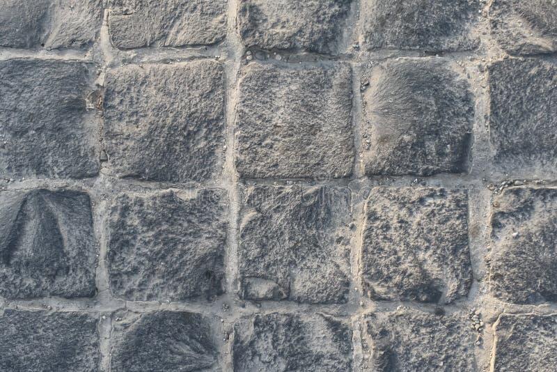 Textura de pavimentación de piedra Resuma el fondo estructurado del modelo moderno de las losas del pavimento de la calle imagen de archivo libre de regalías
