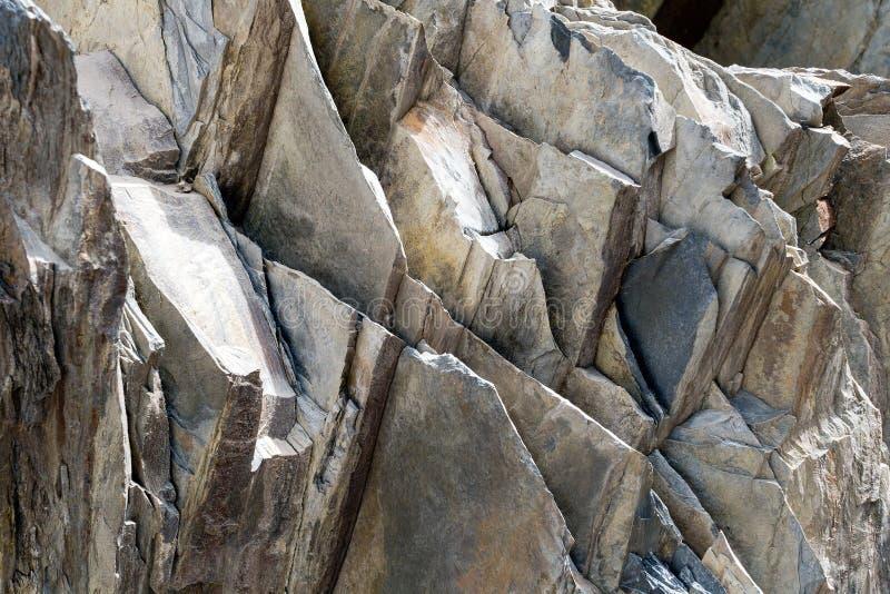 Textura de pedra cinzenta de camadas da rocha Bacground fotografia de stock