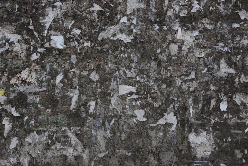 Textura de pedra cinzenta do muro de cimento velho sujo de uma construção foto de stock royalty free
