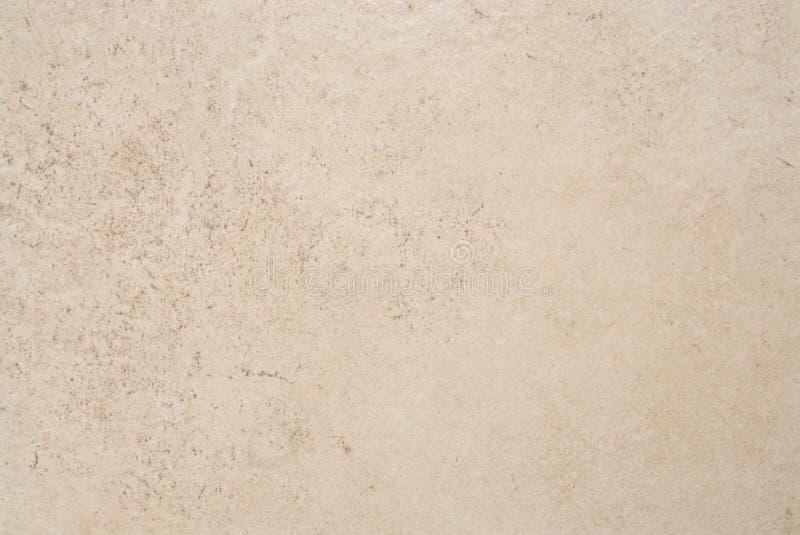 Textura de pedra marrom de creme da telha imagem de stock royalty free