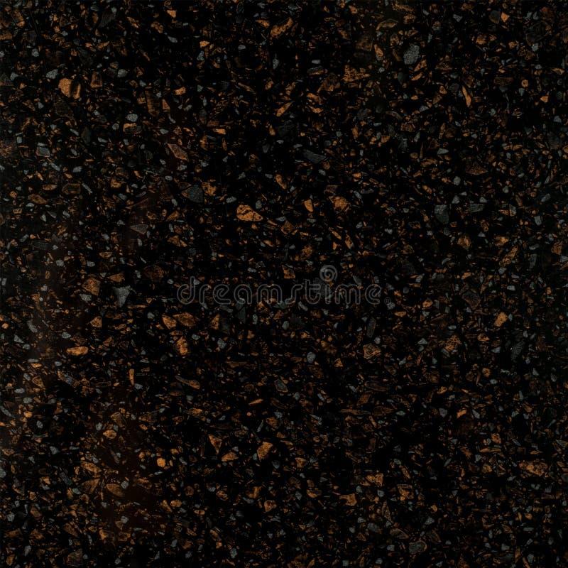 Textura de pedra preta do granito com pontos amarelos fotografia de stock