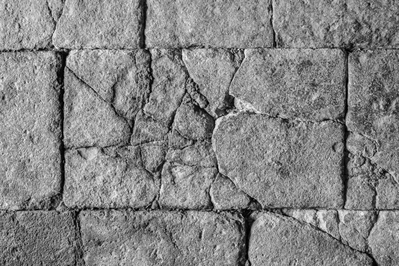 Textura de pedra rachada, assoalho de pedra antigo/parede com quebras fotografia de stock royalty free