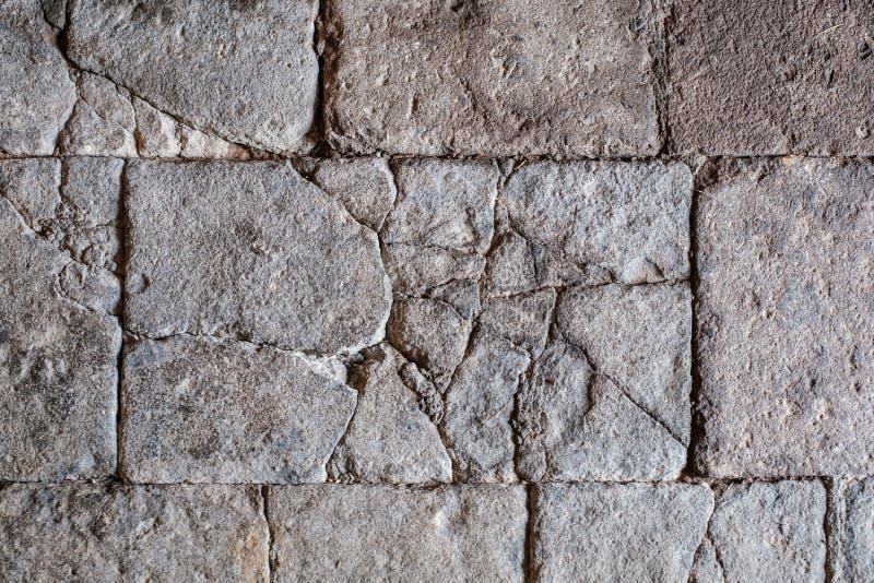 Textura de pedra rachada, assoalho de pedra antigo/parede com quebras fotografia de stock