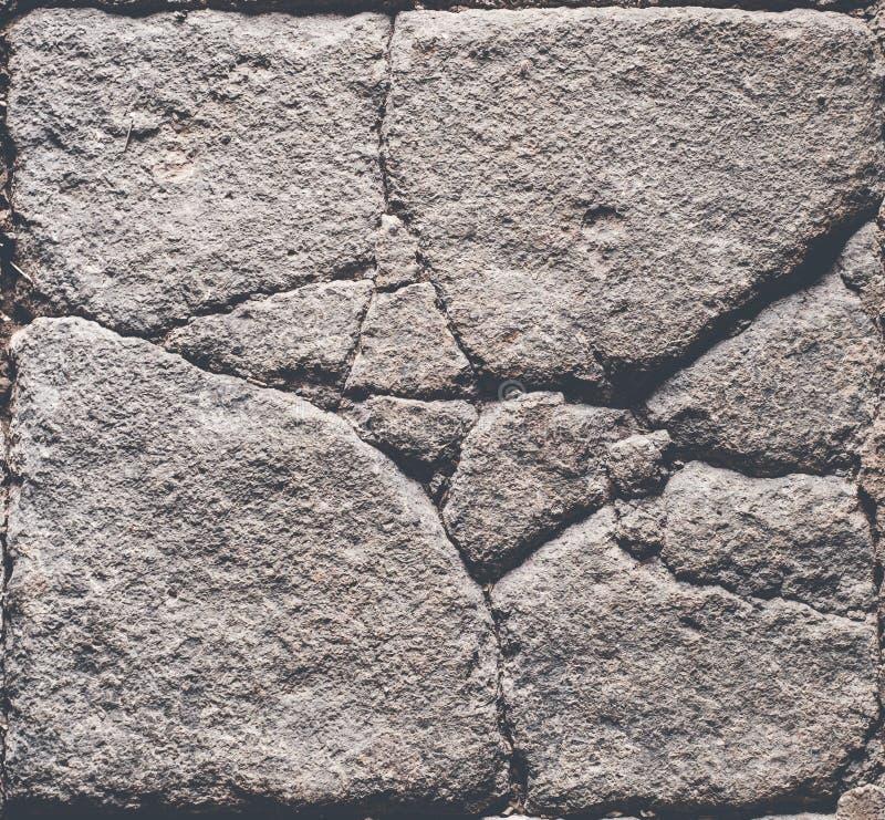 Textura de pedra rachada, assoalho de pedra antigo/parede com quebras foto de stock royalty free