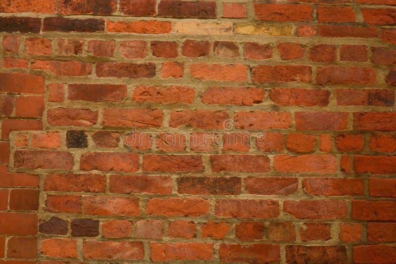 Textura de pedra real velha, alaranjada da parede de tijolo, fundo da parede de tijolo fotografia de stock royalty free