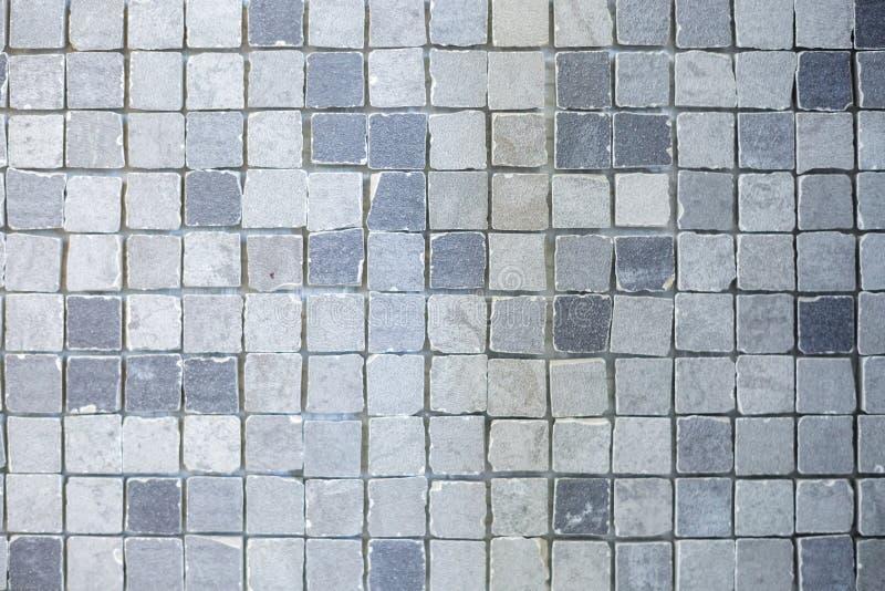 Textura de pequeñas baldosas cerámicas en un fondo caótico de la manera para el interior de la élite del cuarto de baño, del wc,  foto de archivo libre de regalías