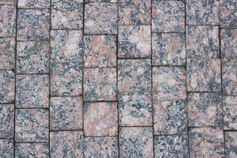 Textura de piedra del pavimento El adoquín del granito empedró el fondo abstracto horizontal Primer imagen de archivo
