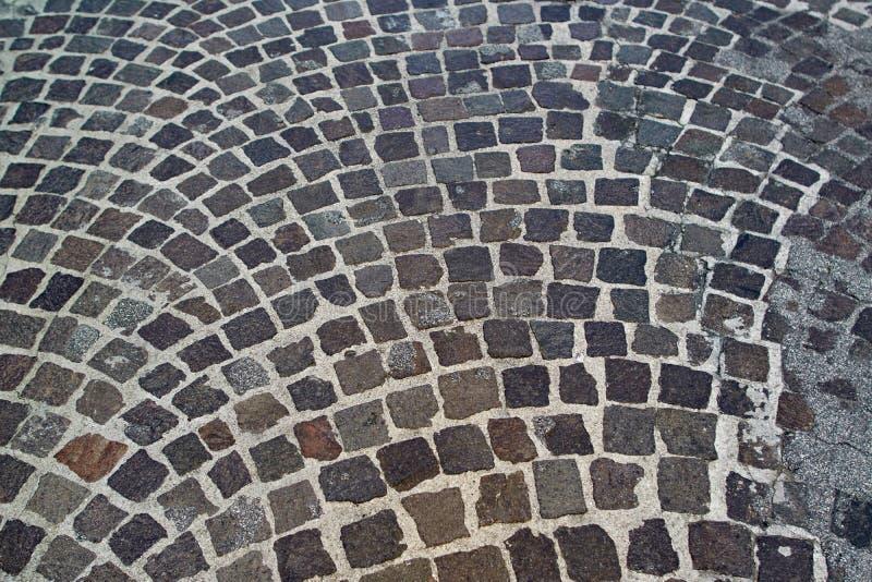 Textura de piedra del pavimento Fondo abstracto del primer viejo del pavimento del guijarro foto de archivo libre de regalías
