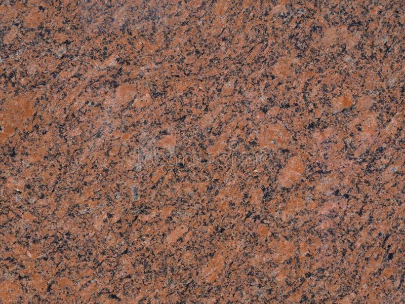 Textura de piedra roja y negra pulida de la fachada - vagos de mármol foto de archivo libre de regalías