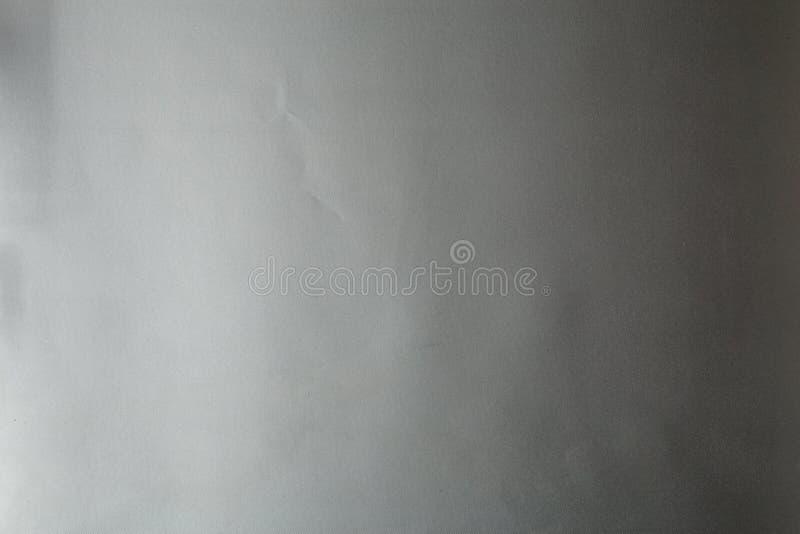 Textura de plata de la tela, superficie metálica gris para el fondo imagenes de archivo