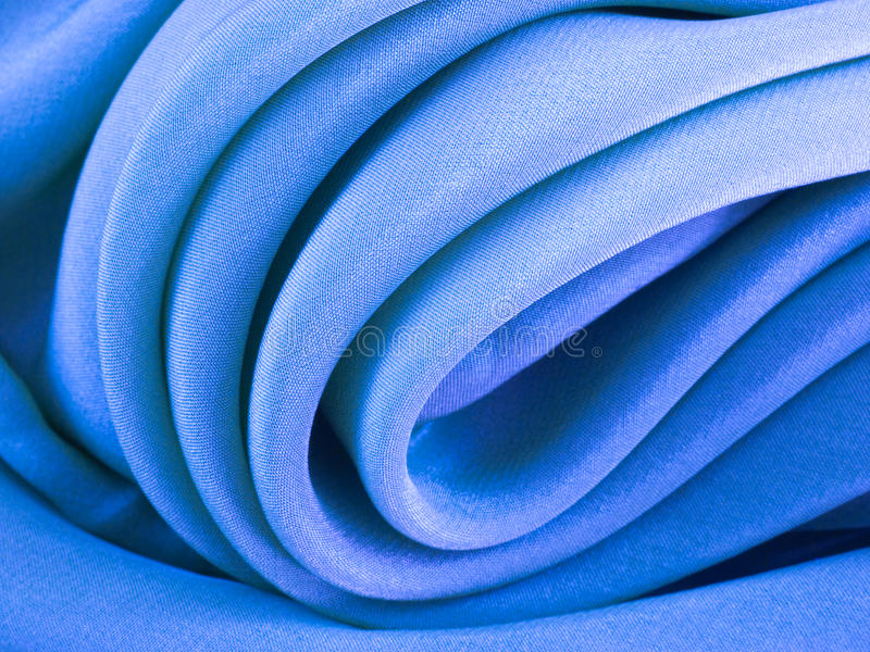Textura de seda azul curvada del paño foto de archivo