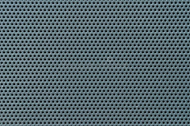Textura de superfície de folha de metal perfurada, macro imagem de stock royalty free