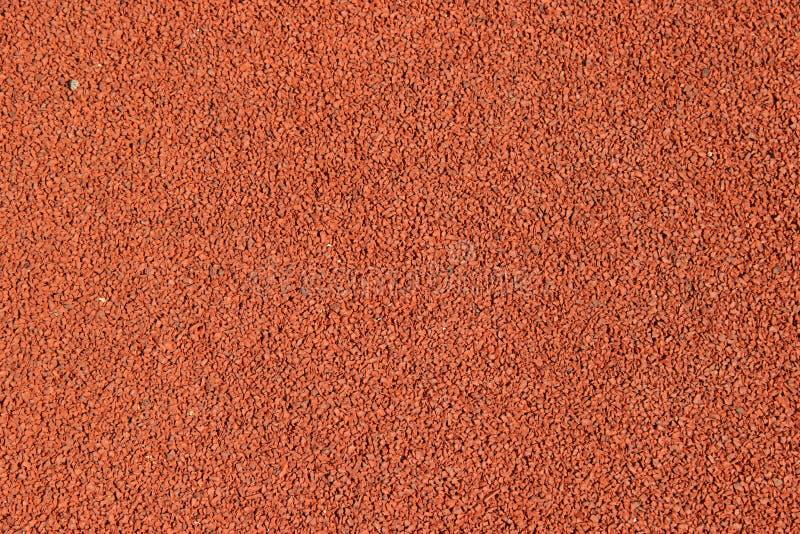 A textura de um asfalto de borracha da migalha de borracha é usada nos estádios para a pista de atletismo imagem de stock