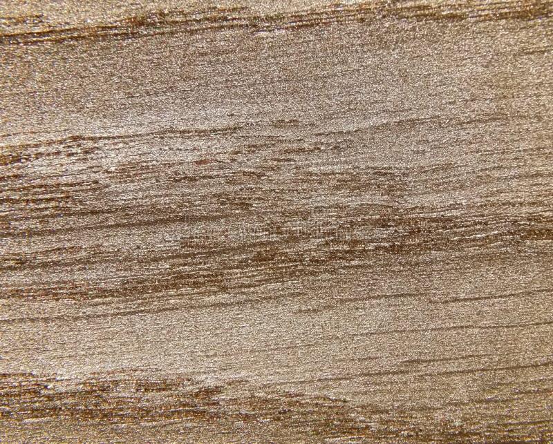 A textura de uma árvore coberta com o ouro fotos de stock