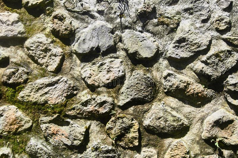 Textura de uma parede de pedra Fundo velho da textura da parede de pedra do castelo Parede de pedra como um fundo ou uma textura foto de stock royalty free