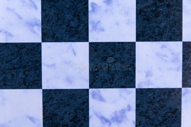 Textura de uma placa de xadrez para o fundo imagem de stock