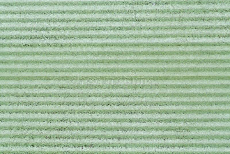 Textura de uma superfície de metal verde imagens de stock